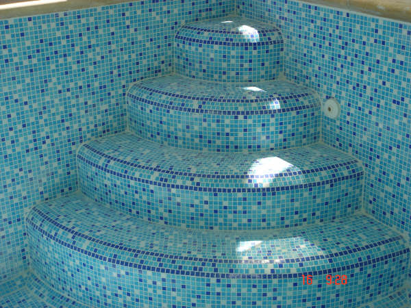 pool with mosaic corner steps