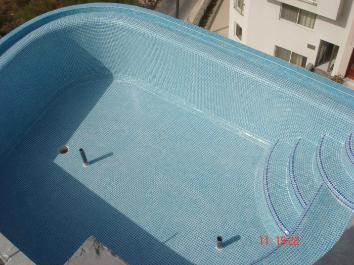 rounded pool with mosaic